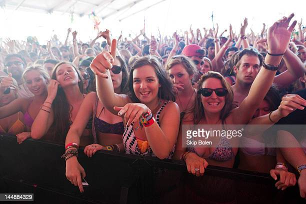 Fans and revelers enjoying the music as Skrillex performs on stage during the 2012 Hangout Music Festival on May 19 2012 in Gulf Shores Alabama