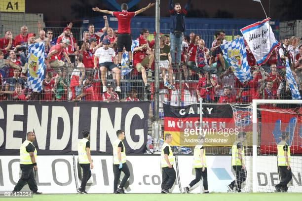 Fans and security of Unterhaching during the Third League Playoff leg two match between SV Elversberg and SpVgg Unterhaching at Ursapharmarena on May...