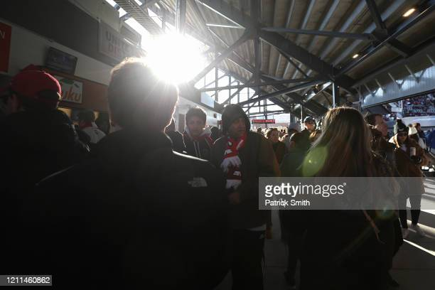 Fans and spectators walk through the concourse during halftime as Inter Miami plays DC United during the second half at Audi Field on March 7 2020 in...