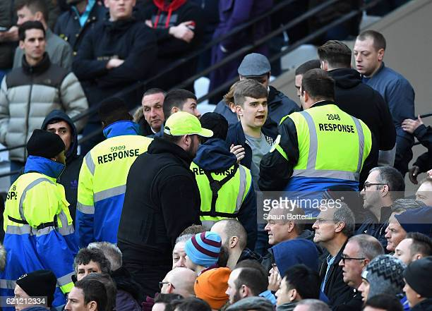 Fans and stewards argue during the Premier League match between West Ham United and Stoke City at Olympic Stadium on November 5 2016 in London England