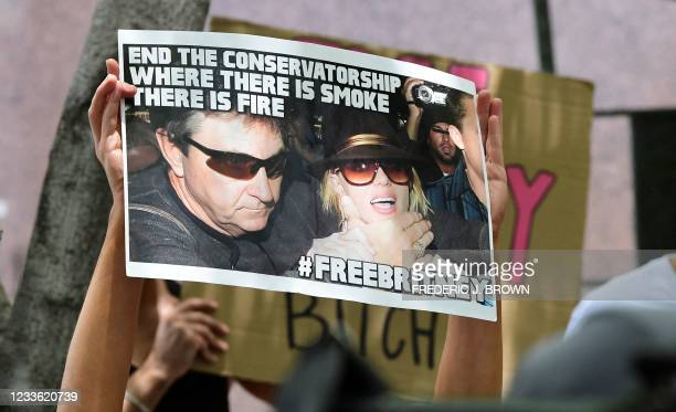 Fans and supporters of Britney Spears hold placards as they gather outside the County Courthouse in Los Angeles, California on June 23 during a...