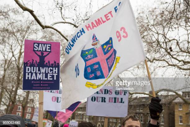 Fans and supporters of Dulwich Hamlet Football Club during a protest march from Goose Green to Champion Hill on 17th March 2018 in South London in...