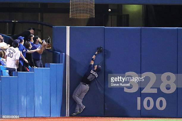 TORONTO ON SEPTEMBER 12 Fans and Tampa Bay Rays left fielder Mikie Mahtook watch as Ezequiel Carrera's hit clears the wall Ezequiel Carrera hits the...