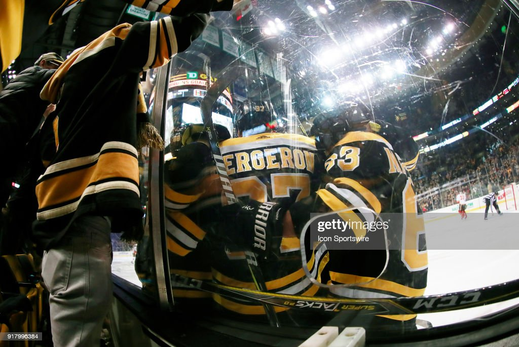 Fans and teammates celebrate the goal from Boston Bruins center Patrice Bergeron (37) that eventually won the game during a game between the Boston Bruins and the Calgary Flames on February 13, 2018, at TD Garden in Boston, Massachusetts. The Bruins defeated the Flames 5-2.