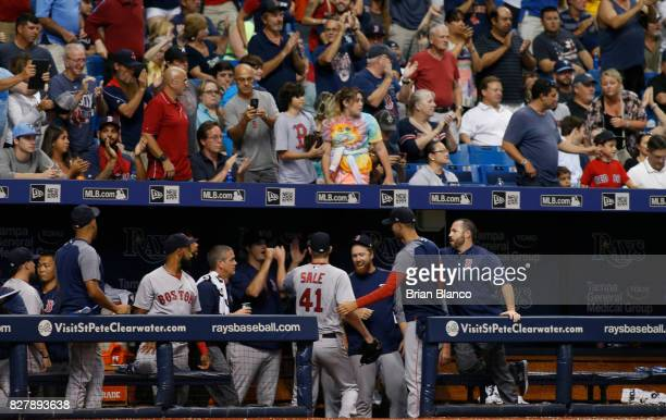 Fans and teammates greet pitcher Chris Sale of the Boston Red Sox as he comes into the dugout following the eighth inning of a game on August 8 2017...
