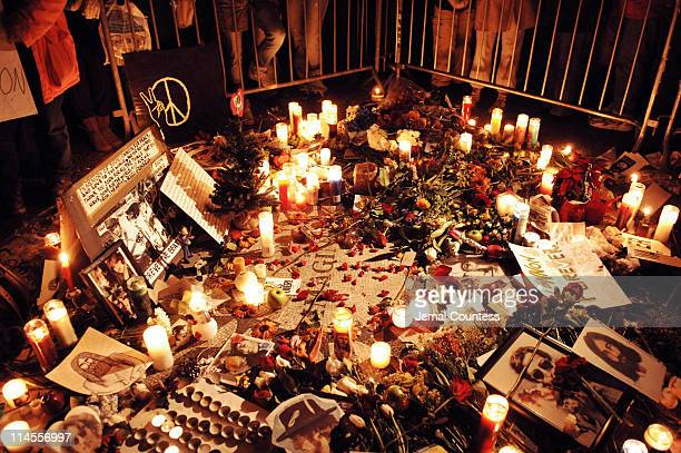 Fans and well wishers come to pay their respects to John Lennon on the 25th anniversery of his assasination at Strawberry Fields in Central Park on...