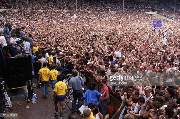 Fans and yellowshirted security guards at the Live Aid Concert at Wembley Stadium 13th July 1985