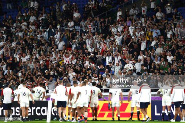 Fans applaud as the England team do a lap of honour during the Rugby World Cup 2019 SemiFinal match between England and New Zealand at International...