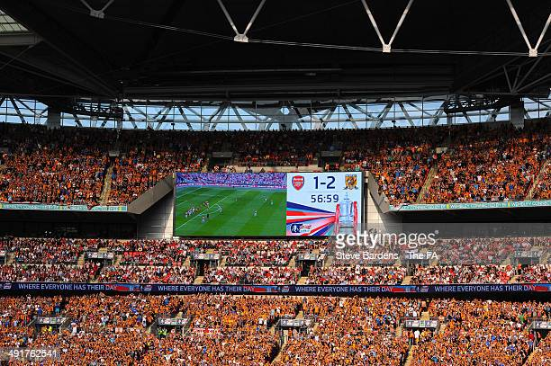 Fans applaud during the 56th minute of the match in memory of the 56 people who lost their lives in the Bradford City stadium fire during the FA Cup...