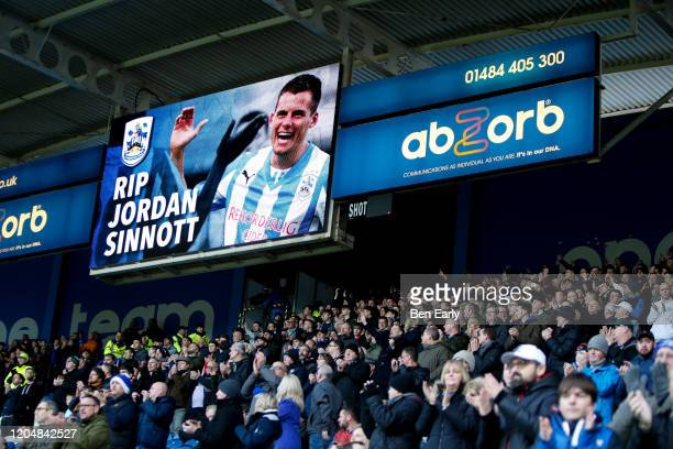 Fans applaud on the 25th minute in a tribute to Jordan Sinnott during the Sky Bet Championship match between Huddersfield Town and Queens Park...