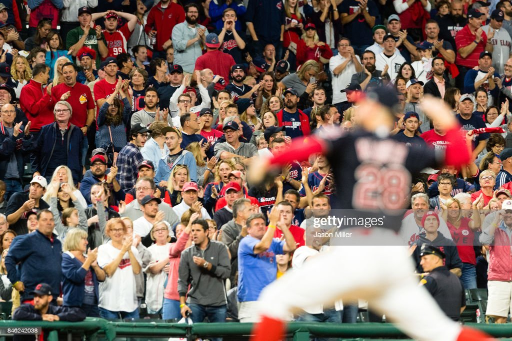 Fans applaud starting pitcher Corey Kluber #28 of the Cleveland Indians as he warms up to start the ninth inning against the Detroit Tigers at Progressive Field on September 12, 2017 in Cleveland, Ohio. The Indians defeated the Tigers for their 20th straight win.