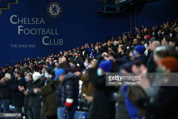 Fans applaud the players of Chelsea as they enter the pitch prior to the Premier League match between Chelsea and Leeds United at Stamford Bridge on...
