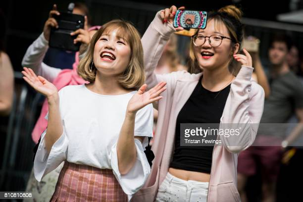 Fans applaud the UK Preliminary of the KPop World Festival contest during the London Korean Festival 2017 at Olympia London on July 8 2017 in London...