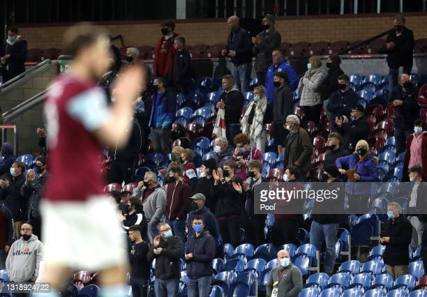 Fans applaud their team off of the pitch following the Premier League match between Burnley and Liverpool at Turf Moor on May 19, 2021 in Burnley,...