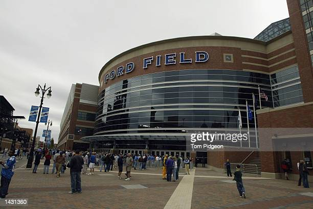 Fans approach Ford Field for the first regular season game in the new facility for the Detroit Lions before the game against the Green Bay Packers on...