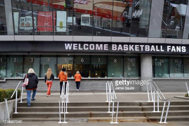 Fans approach the ticket window of the Sprint Center as no fans will be allowed inside for the remainder of the Big 12 tournament games at the Sprint...