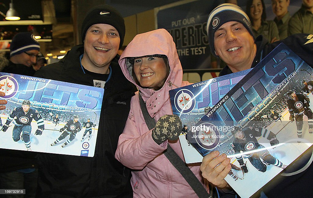 Fans are all smiles as they show off their 3D posters given away following a 4-1 loss for their home team Winnipeg Jets to the Ottawa Senators at the MTS Centre on January 19, 2013 in Winnipeg, Manitoba, Canada.