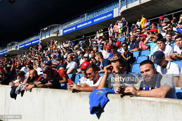 Fans are allowed in the stadium for the first time after the Covid19 crisis during the friendly match between HAC Le Havre and Paris Saint Germain at...