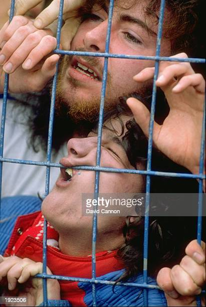 Fans are crushed against the fence before the FA Cup semifinal between Liverpool and Nottingham Forest at the Hillsborough Stadium in Sheffield...