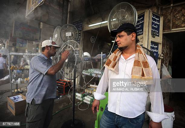 Fans are displayed at a shop selling cooling and ventilation products on July 20 2016 in the capital Baghdad on the first day of a twoday official...