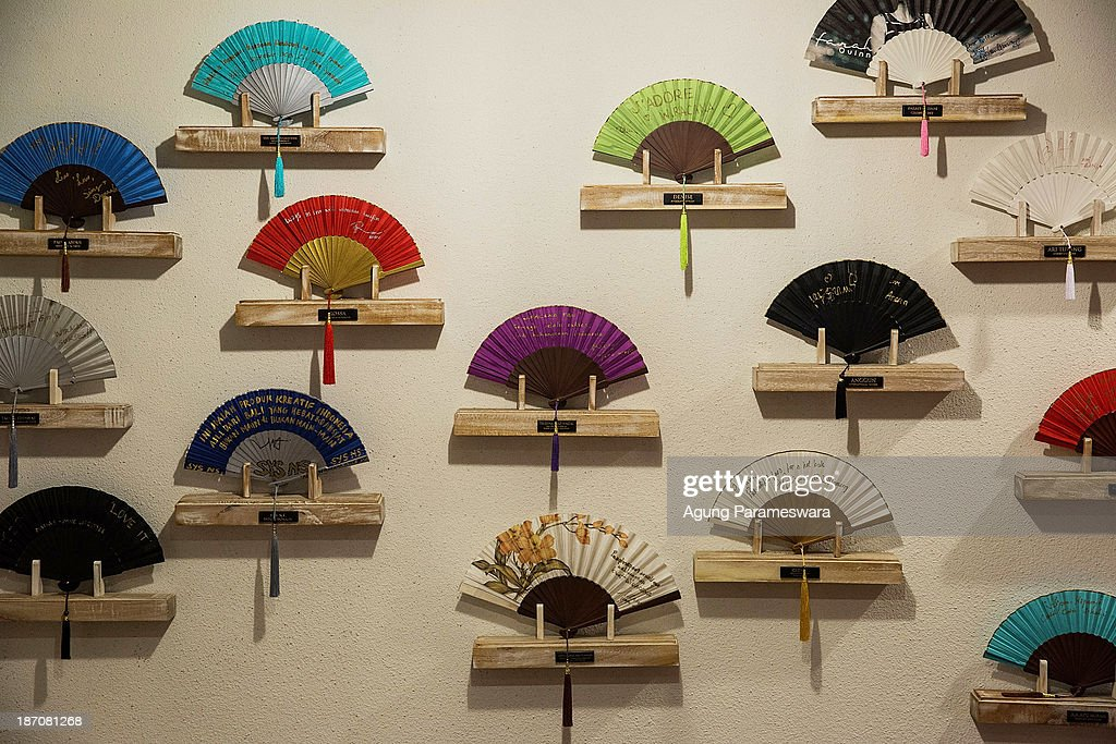 Fans are displayed at aWiracana store on November 6, 2013 in Denpasar, Bali, Indonesia. The Balinese handheld fan trade has traditionally been a home business, with fans being crafted by hand. The company Wiracana set out to break into the highly competitive handheld fan market by using machinery to boost production levels and thus increase the presence of Balinese fan craft within the industry.