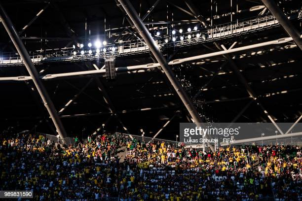 Fans are lit by the sun during the 2018 FIFA World Cup Russia Round of 16 match between Brazil and Mexico at Samara Arena on July 2 2018 in Samara...