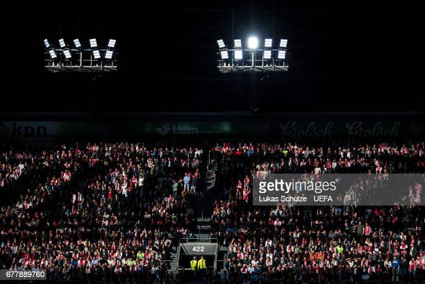Fans are lit by the sun during the Uefa Europa League semi final first leg match between Ajax Amsterdam and Olympique Lyonnais at Amsterdam Arena on...