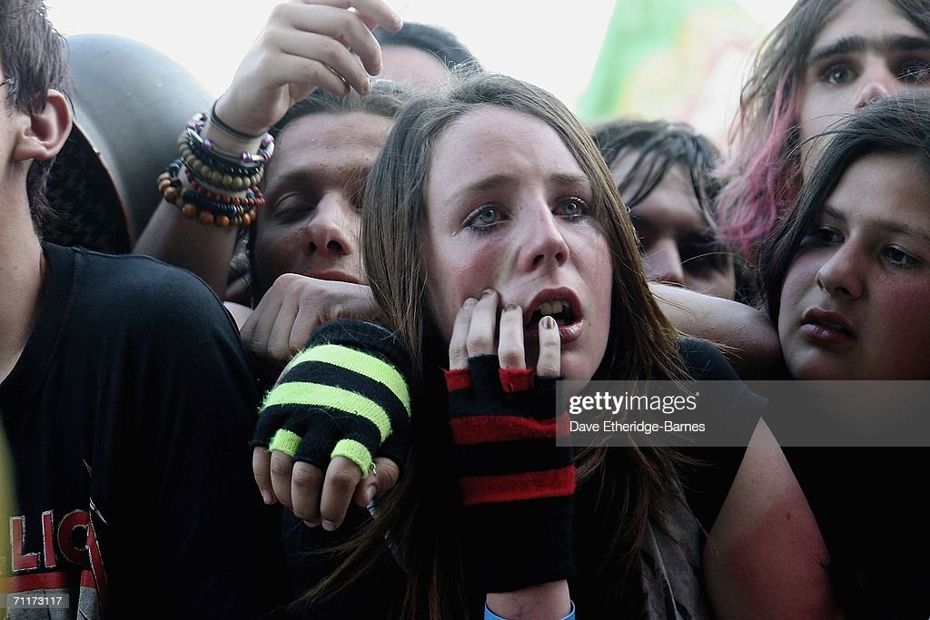 Fans are overcome with heat exhaustion in front of the main stage on Day 2 of the Download Festival on June 10, 2006 in Castle Donington, England.