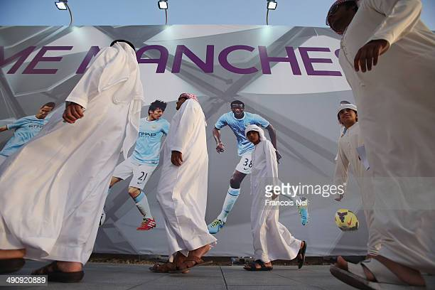 Fans are pictured ahead of the friendly match between Al Ain and Manchester City at Hazza bin Zayed Stadium on May 15 2014 in Al Ain United Arab...