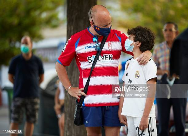 Fans are pictured outside the stadium ahead of the Liga match between Granada CF and Real Madrid CF at Nuevo Los Carmenes on July 13 2020 in Granada...