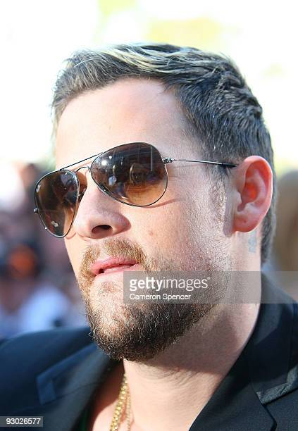 Fans are reflected in the sunglasses of Joel Madden of Good Charlotte as he arrives for the Australian Nickelodeon Kids' Choice Awards 2009 at...