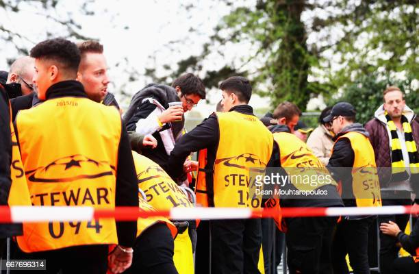 Fans are searched by stewards prior to the UEFA Champions League Quarter Final first leg match between Borussia Dortmund and AS Monaco at Signal...