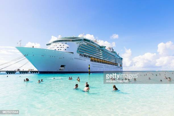 Fans are seen at the beach in front of the Cruise liner 'Independence of the Seas' during the '70000 Tons of Metal' Heavy Metal Cruise Festival on...