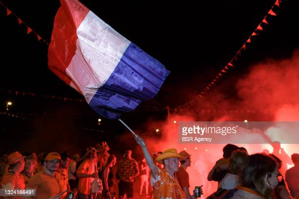 Fans are seen celebrating the victory of the Dutch national football team against Austria during EURO 2020 on June 17, 2021 in Apeldoorn,...