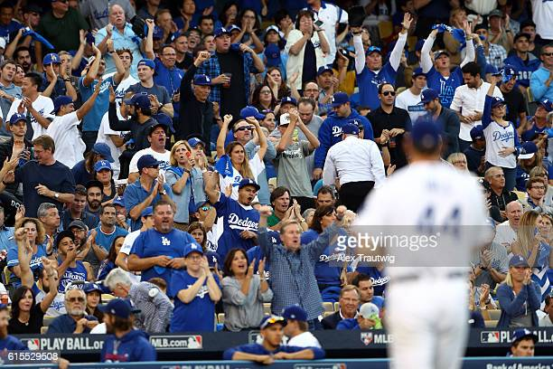 Fans are seen cheering as Rich Hill of the Los Angeles Dodgers walks back to the dugout during Game 3 of the NLCS between the Chicago Cubs and the...