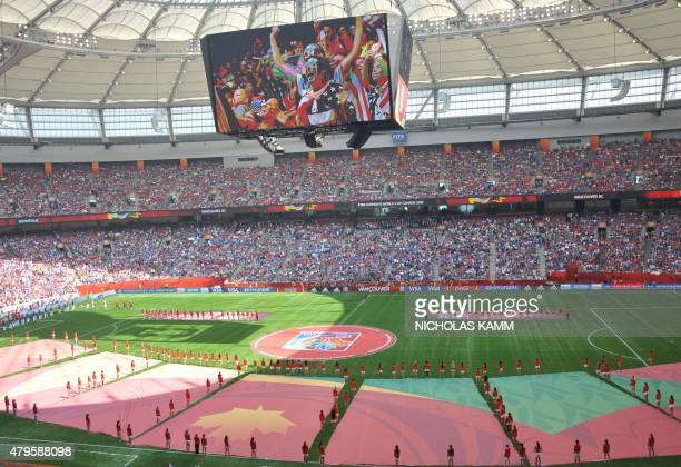 Fans are seen cheering on the stadium display before the 2015 FIFA Women's World Cup final between the USA and Japan at BC Place Stadium in...