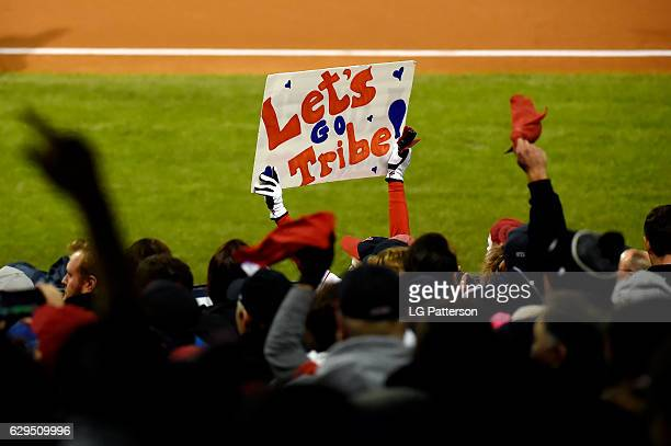 Fans are seen holding up signs and waving rally towels during Game 1 of the 2016 World Series between the Chicago Cubs and the Cleveland Indians at...