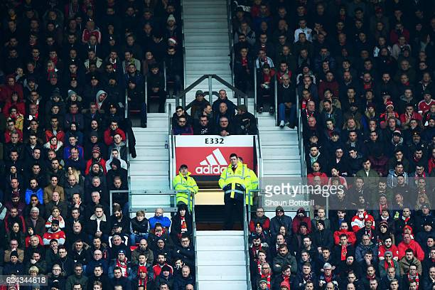 Fans are seen in a small section between main seating blocks during the Premier League match between Manchester United and Arsenal at Old Trafford on...