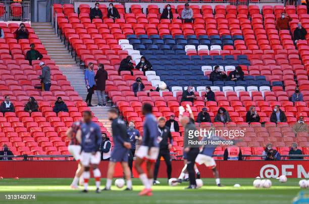 Fans are seen in the stands as the players warm up prior to the Semi Final of the Emirates FA Cup between Leicester City and Southampton FC at...