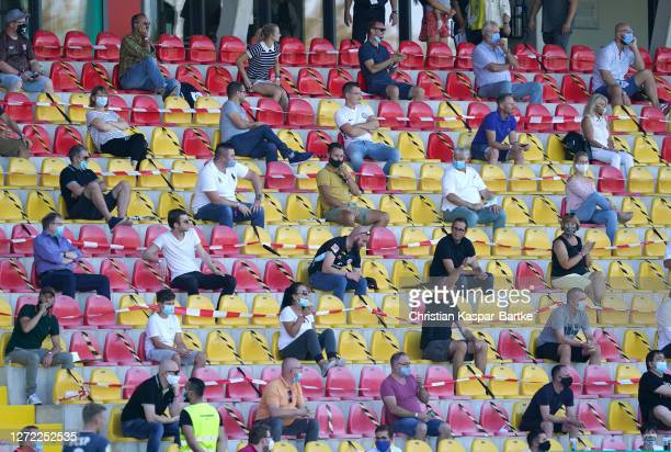 Fans are seen inside the stadium abiding to social distancing rules during the DFB Cup first round match between SV Elversberg and FC St. Pauli at...