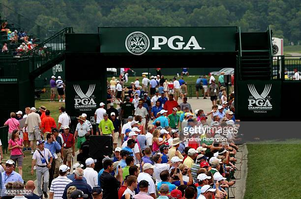 Fans are seen near the practice ground during a practice round prior to the start of the 96th PGA Championship at Valhalla Golf Club on August 5,...