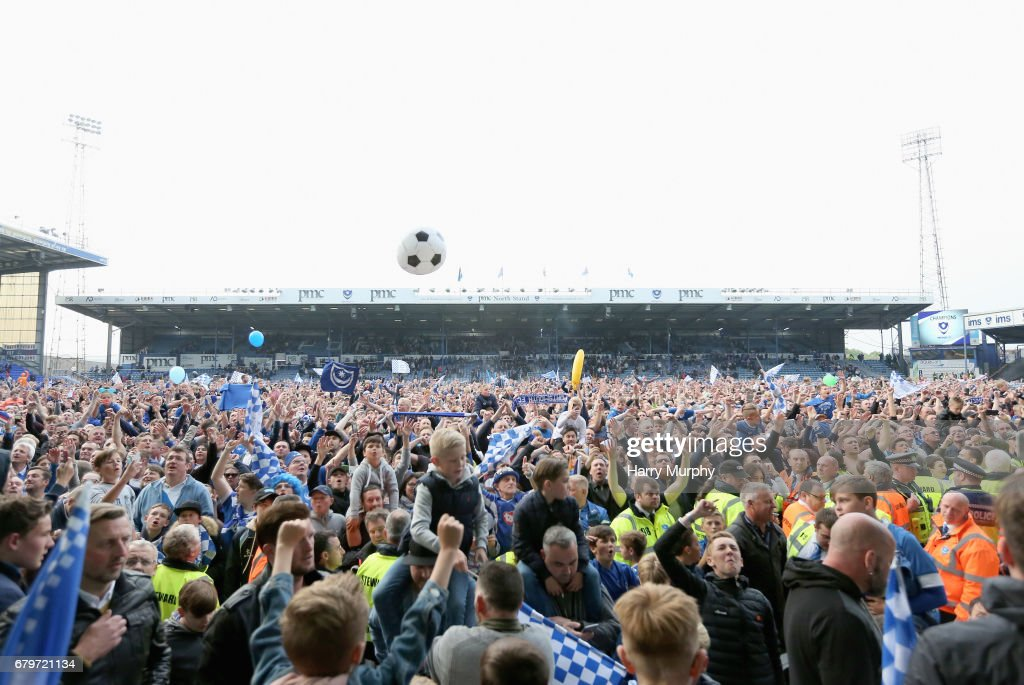Fans are seen on the pitch after the Sky Bet League Two match between Portsmouth and Cheltenham Town at Fratton Park on May 6, 2017 in Portsmouth, England.