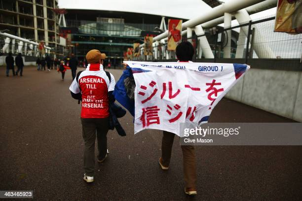 Fans are seen outside the ground before the Barclays Premier League match between Arsenal and Fulham at Emirates Stadium on January 18 2014 in London...
