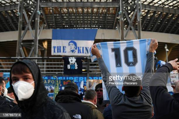 Fans are seen outside the stadium to honour the deceased Diego Maradona prior to the UEFA Europa League Group F stage match between SSC Napoli and...