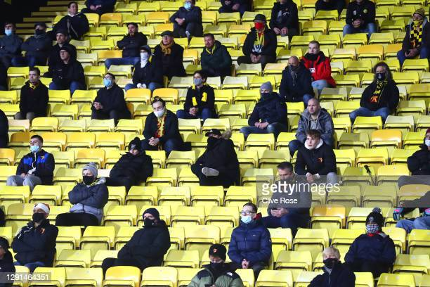 Fans are seen practicing social distancing measures in the stands during the Sky Bet Championship match between Watford and Brentford at Vicarage...