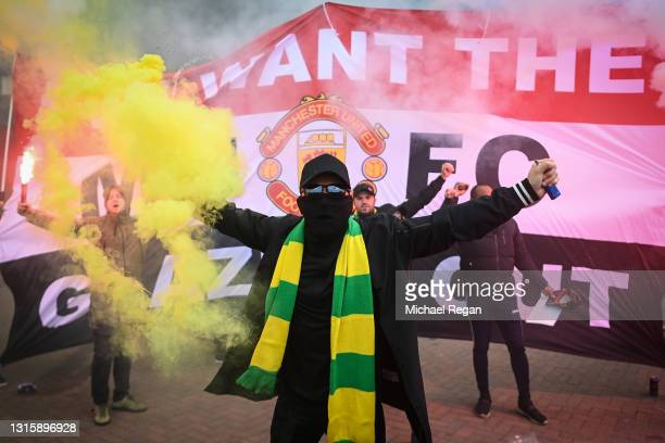 Fans are seen protesting Manchester United's Glazer ownership outside the stadium prior to the Premier League match between Manchester United and...