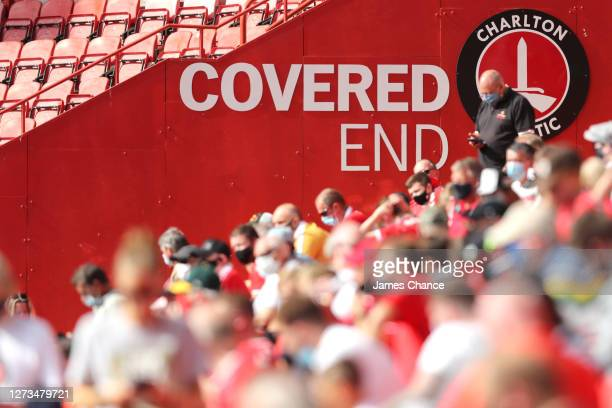 Fans are seen sitting in the covered end of the stadium during the Sky Bet League One match between Charlton Athletic and Doncaster Rovers at The...