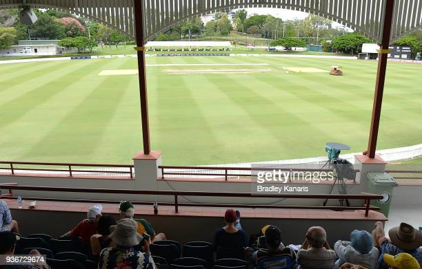 Fans are seen waiting for play to start after previous days of wet weather has caused the field to be wet and has delayed play during day one of the...