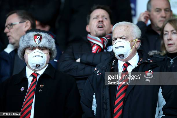 Fans are seen wearing protective face masks in the stand prior to the Premier League match between AFC Bournemouth and Aston Villa at Vitality...