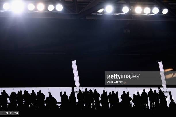Fans are silhouetted during the Bundesliga match between 1 FC Koeln and Hannover 96 at RheinEnergieStadion on February 17 2018 in Cologne Germany